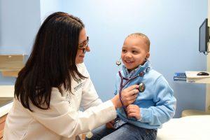 Dr. Mona Hanna-Attisha, examines a young patient. Photo: Courtesy Hurley Children's Center