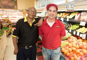 Landmark Food's Fenton Store Manager Bradley Seiba and Eddie Fitzpatrick are proud of their store's fresh food offerings. Photo: Paul Engstrom