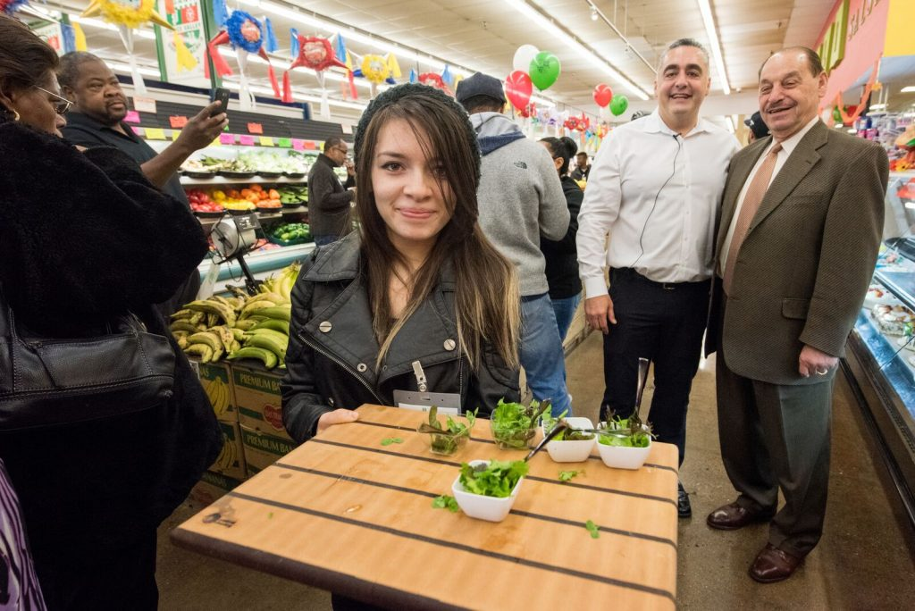 Many grocers encourage sampling of healthy food items to promote sales and community health. Photo: Paul Engstrom