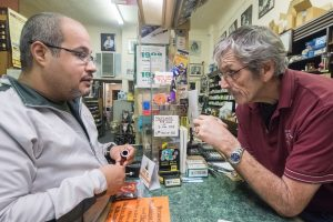 Customers visiting Paul's Pipe Shop learn about the history, culture, and craft of pipes.