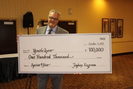Piano man raises $100,000 for Flint youth