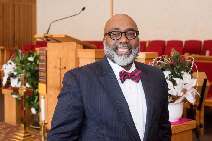 Pastor Reginald Flynn feeds Flint's transformation efforts
