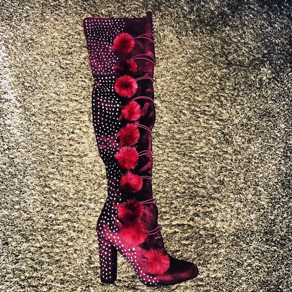 Philip Loving's collections encompass not only shoes but boots, as in these maroon thigh-high creations embellished with paint and pom-pons.