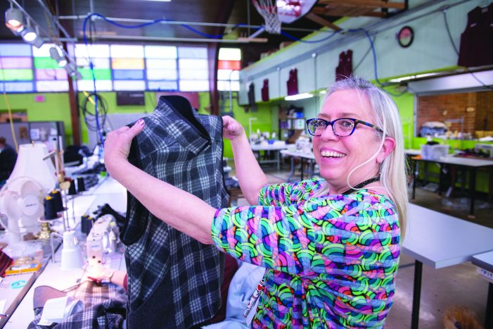 Community collaboration turns plastic bottles into clothing at Flint Fit, adds manufacturing opportunities